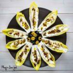 Barchette di indivia belga farcita con caprino noci e olive