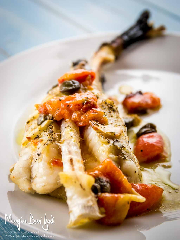 Coda di rana pescatrice al forno con pomodorini e capperi